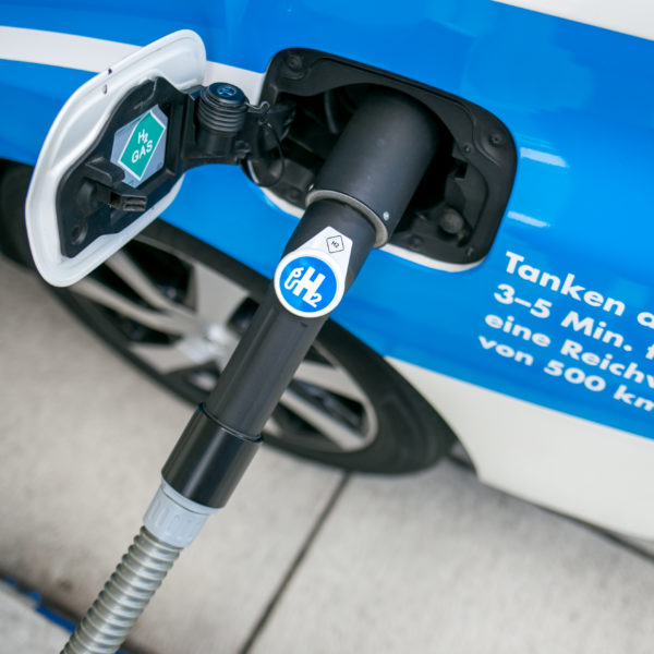 Hydrogen car being refueled